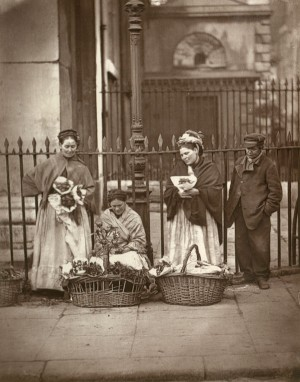 Photo of women selling flowers on street