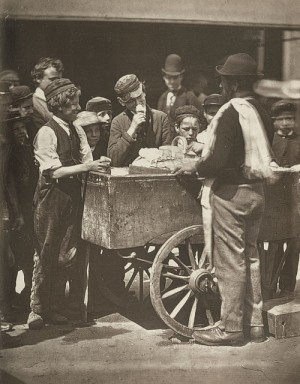 Photo of boys buying ices from street vendor