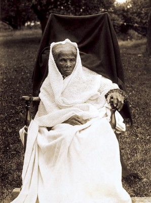 Photo of Harriet Tubman, seated in chair, wearing white shawl and dress